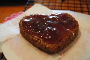 spread strawberry jam on the first layer