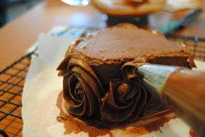 swirl up, and finish when the icing meet the rose shape next to it