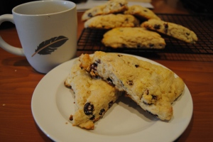 a feather mug and scone to make my day